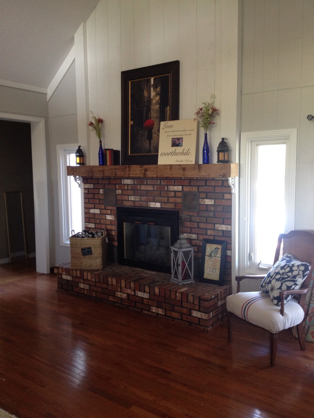 wood grain and pretty stain making a chunky stained fireplace mantle