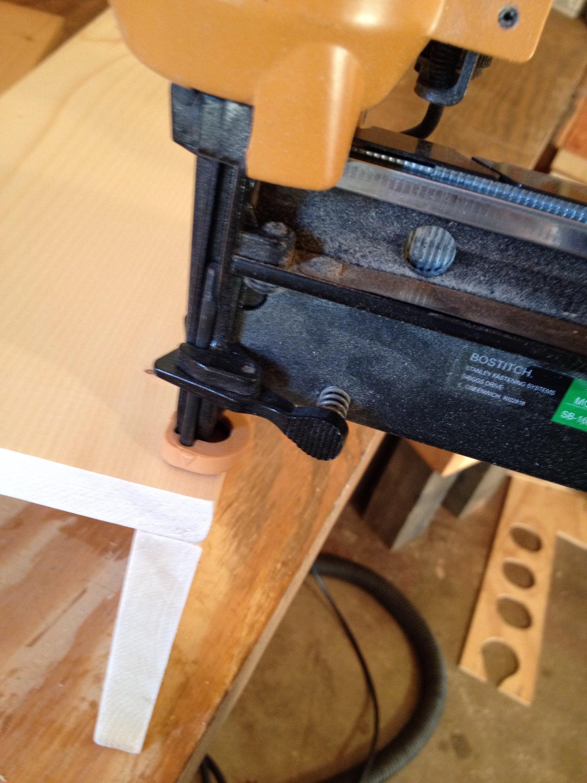 Using nail gun to assemble centerpiece box sides