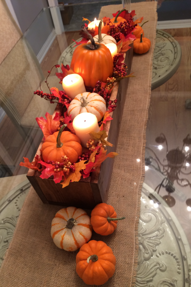 Vertical centerpiece box with pumpkins, candles and leaves for fall