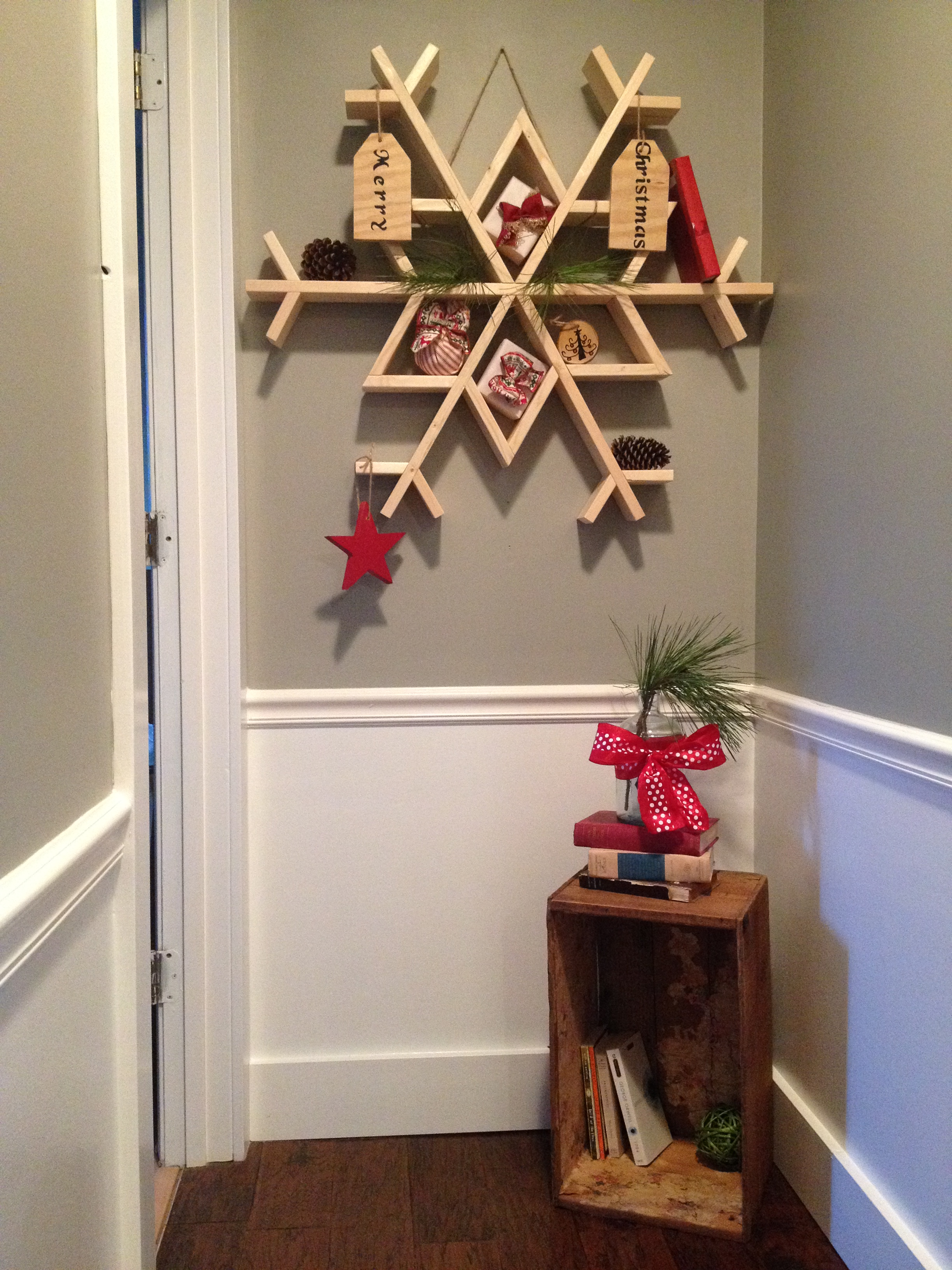 Large DIY snowflake shelf wall decor made from 1x4 boards