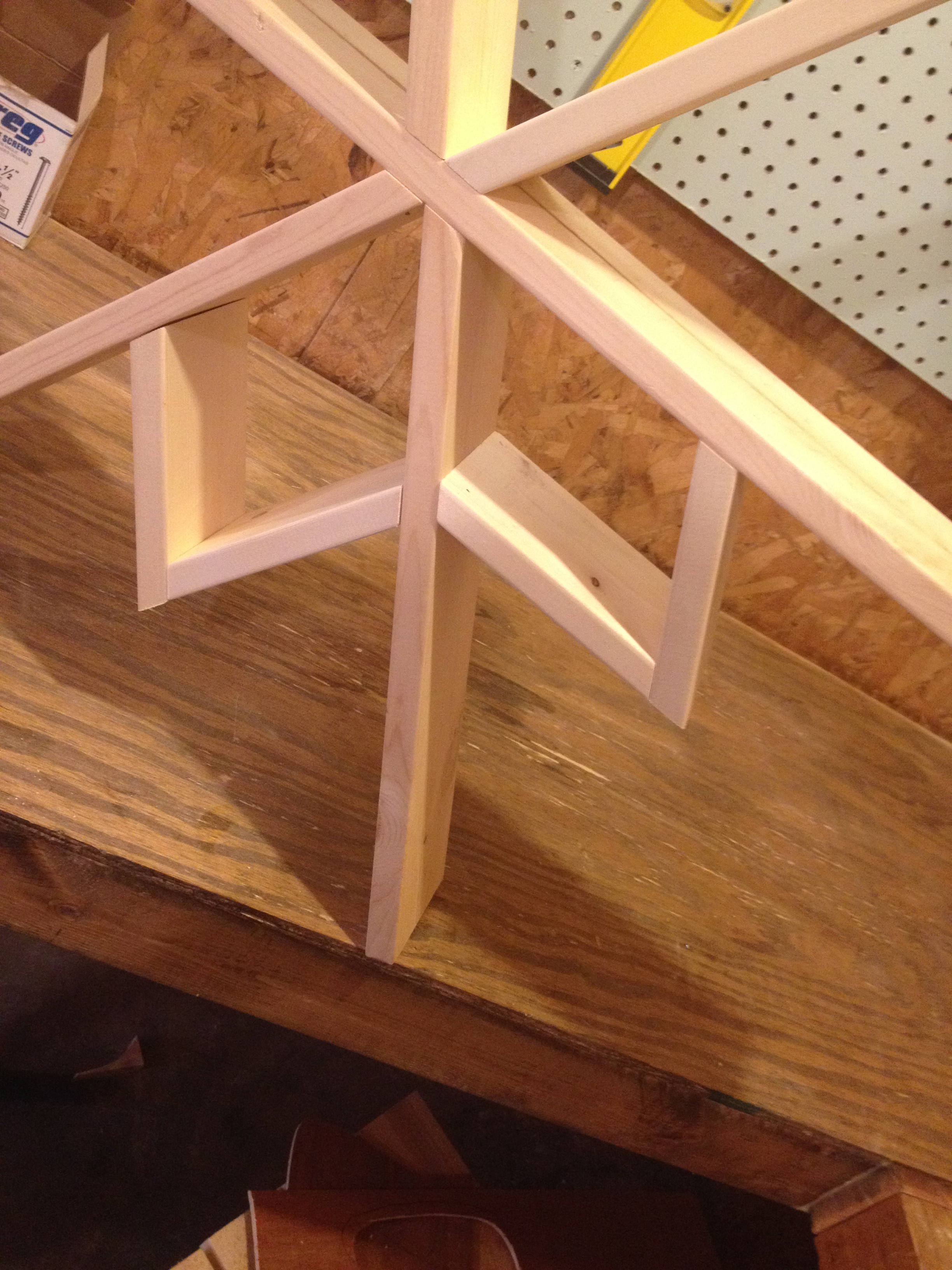Close up of shelf triangles being installed onto shelf frame