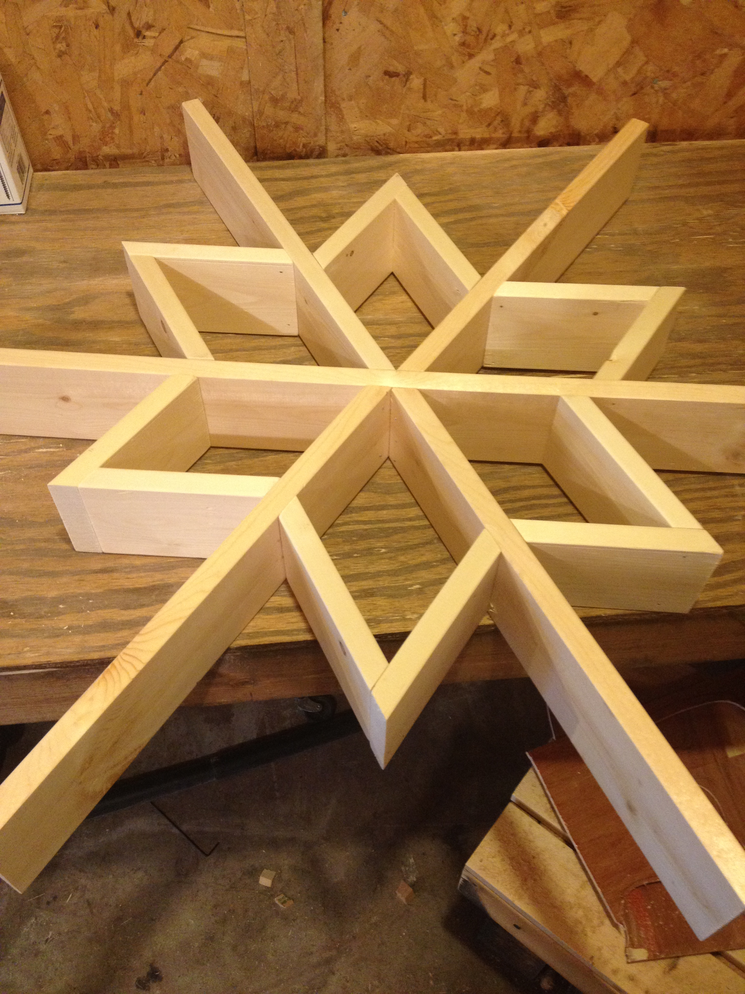 wall shelf assembly in progress--triangles attached to main frame