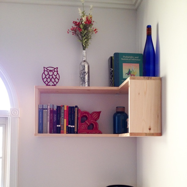 DIY Corner floating shelves hanging on wall in office with books inside